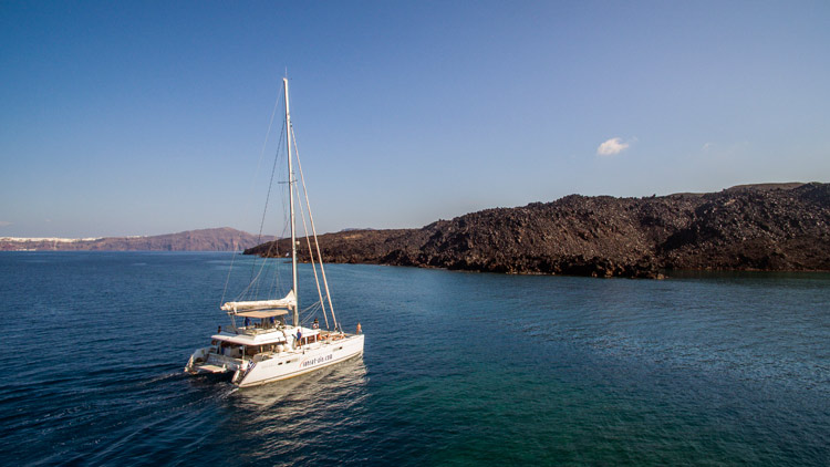 Lagoon 560 Catamaran Sailing Around Santorini