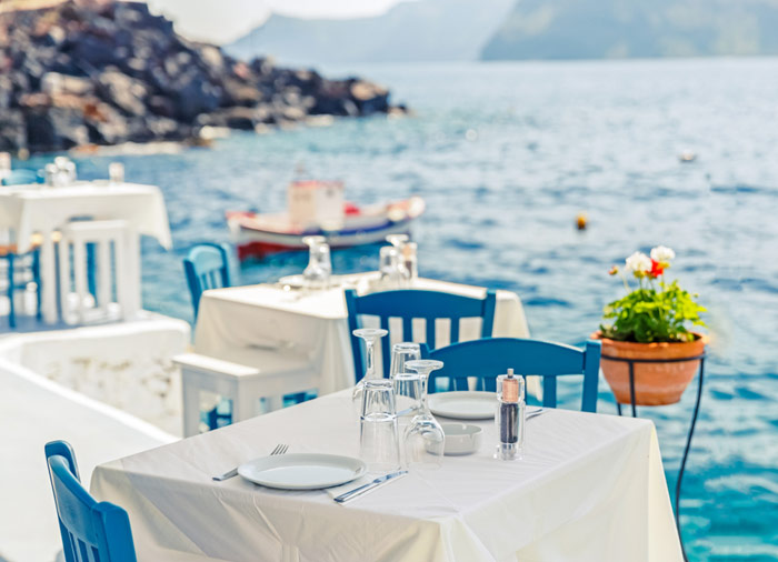 Seafront restaurant – Santorini island, Greek island honeymoon packages with Travelive