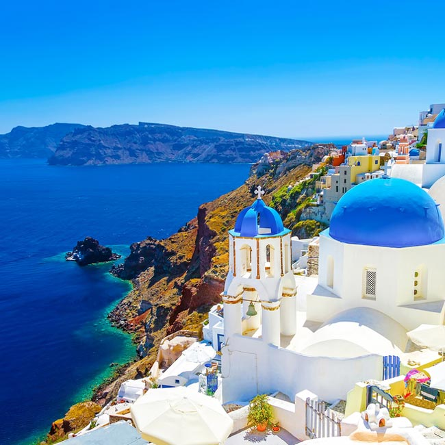 Santorini – Cliffside views, top destinations in Greece, Luxury holidays with Travelive