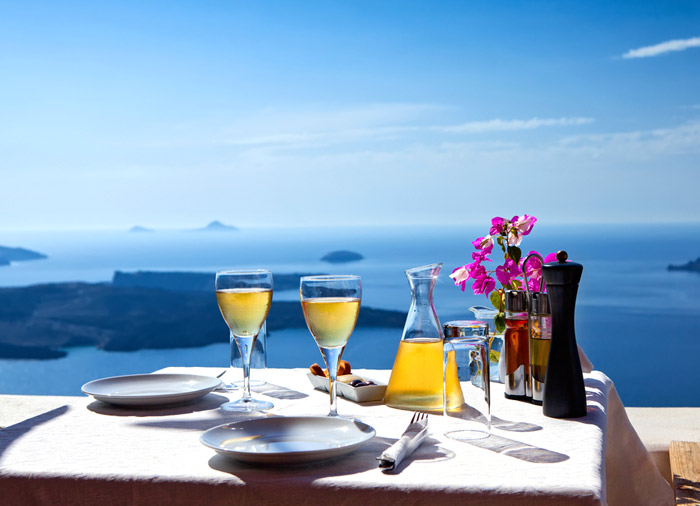 Table Overlooking Sea – romantic dinner Santorini, Athens Mykonos Santorini with Travelive