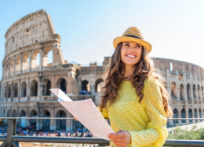 Woman in Front of the Colosseum – Rome Tuscany Florence tours with Travelive